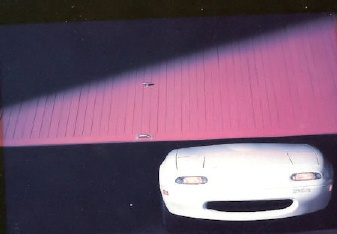 car peeking out of garage