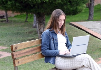 Woman in park working on computer