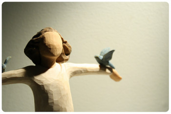 figurine with bluebirds