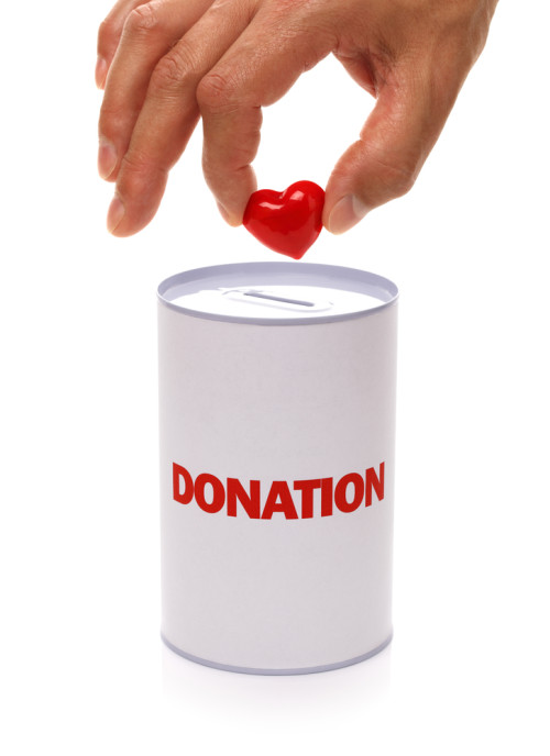 dropping a heart into donation can