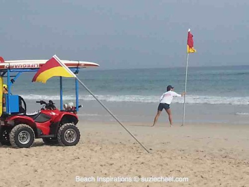 female lifeguards putting out flags
