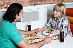 couple-enjoying-dinner-at-a-restaurant-100234263