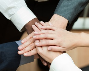 Close-up of people with hands together. Concept of union in busi