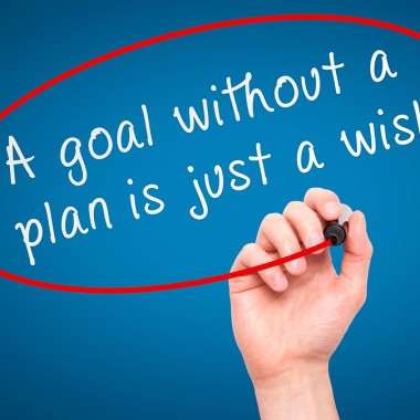 """Man Hand writing """"A goal without a plan is just a wish"""" black ma"""